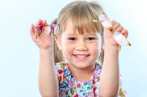 young girl with new glasses
